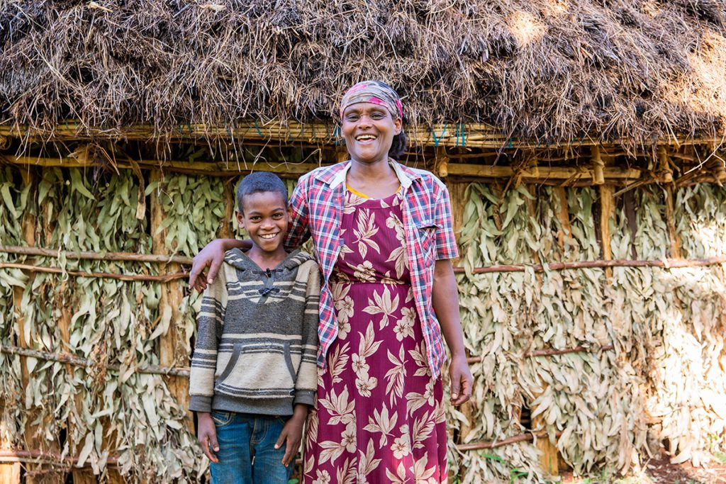 Anteneh and his mother, Aster, outside their home.